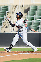 Nomar Mazara (12) of the Hickory Crawdads follows through on his swing against the Kannapolis Intimidators at CMC-Northeast Stadium on May 4, 2014 in Kannapolis, North Carolina.  The Intimidators defeated the Crawdads 3-1.  (Brian Westerholt/Four Seam Images)