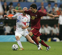 French midfielder (10) Zinedine Zidane goes for the ball in the possession of Portuguese midfielder (20) Deco.  France defeated Portugal, 1-0, in their FIFA World Cup semifinal match at FIFA World Cup Stadium in Munich, Germany, July 5, 2006.