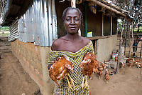 Emma Toe lives in Buchanan, Liberia. BRAC helped supply her with the chickens for their poultry project, each woman has to make her own chicken coop and learn how to raise them. With the money she makes from selling the eggs and chickens she is able to send her five children to school.