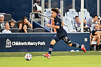KANSAS CITY, KS - AUGUST 10: Cam Duke #28 Sporting KC with the ball during a game between Club Leon and Sporting Kansas City at Children's Mercy Park on August 10, 2021 in Kansas City, Kansas.