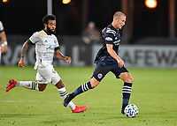 LAKE BUENA VISTA, FL - AUGUST 01: Alexander Ring #8 of New York City FC dribbles away from Eryk Williamson #30 of the Portland Timbers during a game between Portland Timbers and New York City FC at ESPN Wide World of Sports on August 01, 2020 in Lake Buena Vista, Florida.