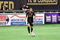 ATLANTA, GA - APRIL 24: Atlanta United midfielder #23 Jake Mulraney dribbles the ball during a game between Chicago Fire FC and Atlanta United FC at Mercedes-Benz Stadium on April 24, 2021 in Atlanta, Georgia.