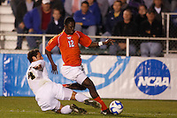 Virginia Tech Hokies forward Patrick Nyarko (12) and Wake Forest Demon Deacons defender Julian Valentin (4) during an NCAA College Cup semi-final match at SAS Stadium in Cary, NC on December 14, 2007. Wake Forest defeated Virginia Tech 2-0.