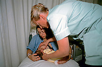 Midwife showing a mother in the maternity unit how to breastfeed her newborn child. This image may only be used to portray the subject in a positive manner..©shoutpictures.com..john@shoutpictures.com