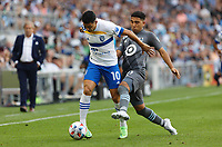 SAINT PAUL, MN - JULY 3: Cristian Espinoza #10 of the San Jose Earthquakes and Emanuel Reynoso #10 of Minnesota United FC battle for the ball during a game between San Jose Earthquakes and Minnesota United FC at Allianz Field on July 3, 2021 in Saint Paul, Minnesota.