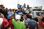 Sky Procycling rider Michael Barry (CAN) signs autographs for local school children before the start of the 3rd Stage of the 2012 Tour of Qatar running 146.5km from Dukhan Souq, Dukhan to Al Gharafa, Qatar. 7th February 2012.<br /> (Photo Eoin Clarke/Newsfile)