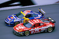 #9 Porsche and #96 Ferrari..2002 Rolex 24 at Daytona, Daytona International Speedway, Daytona Beach, Florida USA Feb. 2002.(Sports Car Racing)