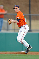 Virginia Cavaliers third baseman Nick Howard #33 throws to first during a game against the Clemson Tigers at Doug Kingsmore Stadium on March 15, 2013 in Clemson, South Carolina. The Cavaliers won 6-5.(Tony Farlow/Four Seam Images).