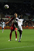 Pictured: Wilfried Bony (R).<br /> Monday 16 September 2013<br /> Re: Barclay's Premier League, Swansea City FC v Liverpool at the Liberty Stadium, south Wales.