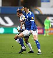 20th March 2021; Liberty Stadium, Swansea, Glamorgan, Wales; English Football League Championship Football, Swansea City versus Cardiff City; Kyle Naughton of Swansea City and Kieffer Moore of Cardiff City challenge for the ball