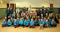 Pat Parkhurst, scout leader (CENTRE IN BEIGE) with children from the scout group