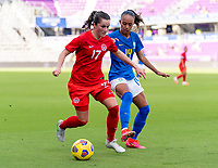 ORLANDO, FL - FEBRUARY 24: Jessie Fleming #17 of Canada is defended by Adriana #14 of Brazil during a game between Brazil and Canada at Exploria Stadium on February 24, 2021 in Orlando, Florida.