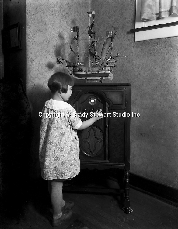 Pittsburgh PA:  Young girl listening to the 1924 Crosely Super Trirdyn Regular radio.