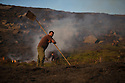10/05/16 <br /> <br /> After eight hours of tackling a fire high up in a remote part of the Peak District between Sheffield and Manchester, game-keepers, Luke Addy  (right) and Kieron Logan (left), take a moment to survey some 200 acres of precious heather moorland that was destroyed today after a BBQ started a fire in the valley below.<br /> <br /> Full story:   http://www.fstoppress.com/articles/peak-district-fire/<br /> <br /> .A small group of gamekeepers spent the night fighting a major blaze blaze covering two hundred acres of heather moorland close to the Derwent and Ladybower reservoirs in the Derbyshire Peak District.<br /> <br /> The fire, which broke out at around 1pm on Monday, is believed to have been started by a disposable barbecue, according to a spokesman for the reservoir, which quickly escalated into a major fire threatening the natural habitat of many wild animals and birds including red grouse, plovers, meadow pipits and hen harriers.<br /> <br /> Ten fire crews were called to tackle the flames, and remained on scene until dusk fell, leaving the job of managing the fire overnight to the gamekeepers on scene.<br /> <br /> Kieran Logan was one of the gamekeepers left battling the flames and he said moorland management policies implemented some 10 years ago by the landowners, The National Trust were also partly to blame.<br /> <br /> All Rights Reserved: F Stop Press Ltd. +44(0)1335 418365   +44 (0)7765 242650 www.fstoppress.com