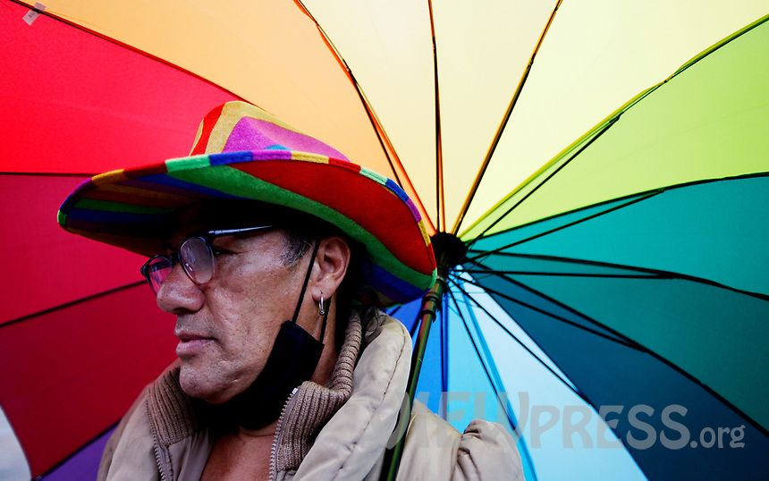 """BOGOTA, COLOMBIA - JULY 03: A member of the LGBTI+ community during a protest against the recent  murders of several members of their community, in Bogota, Colombia, Friday, July 3, 2020. The LGTBI+ community protest against the murder of six trans women this month shouting """"Trans live matter, black trans life matter"""", more than 1300 LGBTI+ people was killed in the last five years in Latin America. (Photo by Leonardo Munoz/VIEWpress via Getty Images)"""