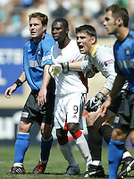 DC United's Freddie Adu is surroundd by San Jose Earthquakes Richard Mulrooney and Pat Onstad during their MLS match on May 1, 2004 at Spartan Stadium in San Jose, California.