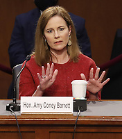 Supreme Court nominee Judge Amy Coney Barrett gestures as she answers questions during the second day of her confirmation hearing before the Senate Judiciary Committee on Capitol Hill in Washington, DC, USA, 13 October 2020.<br /> Credit: Shawn Thew / Pool via CNP /MediaPunch<br /> CAP/MPI/RS<br /> ©RS/MPI/Capital Pictures