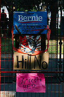 Pro-Bernie and anti-Hillary signs hang on the fence on the outside of the secure area surrounding the Democratic National Convention at the Wells Fargo Center in Philadelphia, Pennsylvania, on Wed., July 27, 2016.