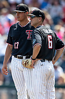 Texas Tech Red Raiders pitcher John McMillon (17) talks with head coach Tim Tadlock (6) during Game 1 of the NCAA College World Series against the Michigan Wolverines on June 15, 2019 at TD Ameritrade Park in Omaha, Nebraska. Michigan defeated Texas Tech 5-3. (Andrew Woolley/Four Seam Images)