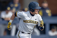 Michigan Wolverines catcher Joe Donovan (0) runs to first base against the San Jose State Spartans on March 27, 2019 in Game 1 of the NCAA baseball doubleheader at Ray Fisher Stadium in Ann Arbor, Michigan. Michigan defeated San Jose State 1-0. (Andrew Woolley/Four Seam Images)
