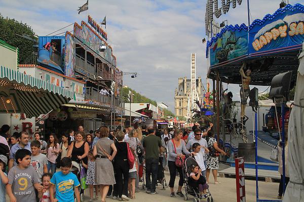 Amusement park in the Jardin des Tuileries and the Louvre Museum, Paris, France.