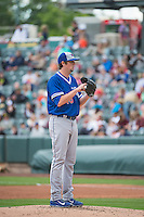 Deck McGuire (46) starting pitcher of the Oklahoma City Dodgers looks for the sign before delivering a pitch to the plate against the Salt Lake Bees in Pacific Coast League action at Smith's Ballpark on May 25, 2015 in Salt Lake City, Utah.  (Stephen Smith/Four Seam Images)