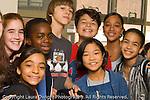 Public School  Middle School happy group of children posing in corridor horizontal