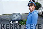 Miriam Moriarty Owens stands by the grave of 5 people who died in the former Magdalene Asylum