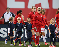 San Diego, Ca - Sunday, January 21, 2018: Megan Rapinoe and Player Escorts during a USWNT 5-1 victory over Denmark at SDCCU Stadium.