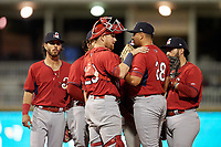 Springfield Cardinals catcher Brian O'Keefe (23) talks with  pitcher Roel Ramirez (28) during a Texas League game against the Frisco RoughRiders on May 4, 2019 at Dr Pepper Ballpark in Frisco, Texas.  (Mike Augustin/Four Seam Images)