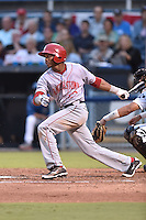 Hagerstown Suns center fielder Rafael Bautista #12 swings at a pitch during a game against the Asheville Tourists at McCormick Field September 8, 2014 in Asheville, North Carolina. The Tourists defeated the Suns 16-7. (Tony Farlow/Four Seam Images)