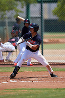 AZL Indians Blue Julian Escobedo (4) squares to bunt during an Arizona League game against the AZL Indians Red on July 7, 2019 at the Cleveland Indians Spring Training Complex in Goodyear, Arizona. The AZL Indians Blue defeated the AZL Indians Red 5-4. (Zachary Lucy/Four Seam Images)