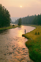 Fly fishing, smokey light from the fires of 1988<br /> Nez Perce Creek<br /> Yellowstone National Park<br /> Rocky Mountains,  Wyoming
