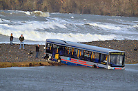 Pictured: The bus which is partially lodged in a flooded plain by the beach in Newgale, Pembrokeshire, west Wales. Sunday 02 February 2014<br />