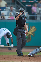 Home plate umpire Steven Jaschinski makes a strike call during the Carolina League game between the Winston-Salem Dash and the Down East Wood Ducks at Grainger Stadium Field on May 17, 2019 in Kinston, North Carolina. The Dash defeated the Wood Ducks 8-2. (Brian Westerholt/Four Seam Images)