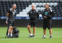 Swansea City's Goalkeeping Coach Adrian Tucker (L) interacts with assistant coaches Alan Curtis (C) and Bjorn Hamberg (R) during the Swansea City Training at The Liberty Stadium, Swansea, Wales, UK. Tuesday 07 August 2018