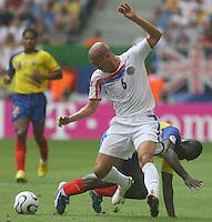 Ecuador's Segundo Castillo (14) and Costa Rica's Danny Fonseca (back) battle for the ball. Ecuador defeated Costa Rica 3-0 in their FIFA World Cup Group A match at FIFA World Cup Stadium, Hamburg, Germany, June 15, 2006.