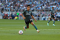 ST PAUL, MN - AUGUST 14: Efraín Alvarez #26 of the Los Angeles Galaxy attacks the ball during a game between Los Angeles Galaxy and Minnesota United FC at Allianz Field on August 14, 2021 in St Paul, Minnesota.