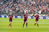 EAST HARTFORD, CT - JULY 5: Megan Rapinoe #15, Alex Morgan #13, and Emily Sonnett #14 of the United States do sprints after the match after a game between Mexico and USWNT at Rentschler Field on July 5, 2021 in East Hartford, Connecticut.
