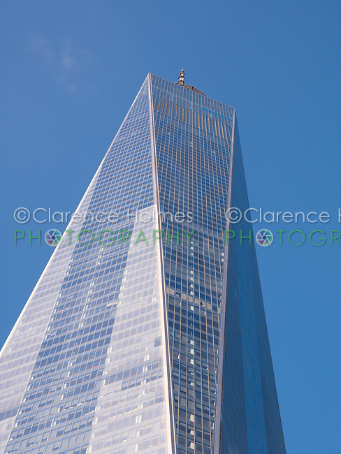 A view of One World Trade Center looking up from the 9/11 Memorial in New York City.