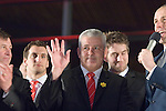 The Welsh rugby team celebrate winning the Grand Slam in the Six Nations rugby tournament at The Senydd in Cardiff Bay..Wales rugby Coach Warren Gatland waves to the crowd.