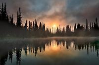 Sunrise and fog on Reflection Lake. Mt. Rainier National Park, Washington