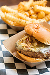 May 8, 2015. Chapel Hill, North Carolina.<br />  The Mookie with a side of fries at Al's Burger Shack. (medium-rare patty smothered in bacon-onion jam, roasted-garlic aioli and blue cheese).<br />  Although relatively new to the Chapel Hill restaurant scene, Al's Burger Shack has become increasingly popular with locals.<br />  Outsiders tend to lump Chapel Hill with nearby Durham, but the more sensible pairing is with Carrboro, the adjacent town that was once a mere offshoot known as West End. Even today the transition from Chapel Hill, anchored by North Carolina''s flagship public university, into downtown Carrboro is virtually seamless.