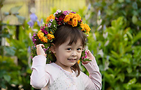 BNPS.co.uk (01202 558833)<br /> Pic: ZacharyCulpin/BNPS<br /> <br /> Pictured: Blythe Woollacott, 3, wears one of the spectacular flower crowns created as part of Garden Day in Southwark<br /> <br /> Londoners celebrate Garden Day by making flower crowns in the gardens of St George the Martyr church in Southwark.  <br /> <br /> Garden Day is back for a third successive year on Sunday, 9th May 2021 to celebrate outdoor and indoor garden spaces. The nationwide movement is called on plant-lovers to make a flower crown, and share their plant spaces with family and<br /> friends