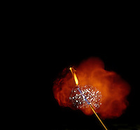 IGNITION OF HYDROGEN SOAP BUBBLES<br /> Exothermic Reaction Between Hydrogen & Oxygen.<br /> As the bubbles float upward, they are ignited using a candle on a long pole. The orange flame is due to the reaction of hydrogen with the oxygen in the air.