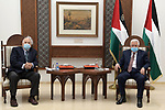 Palestinian President Mahmoud Abbas meets with Chairman of the Palestinian Central Election Committee Nasser Hanna, in the West Bank city of Ramallah, on January 9, 2021. Photo by Thaer Ganaim