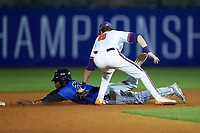 Jalen Phillips (22) of the Duke Blue Devils dives into second base while being tagged out by Logan Davidson (8) of the Clemson Tigers in Game Three of the 2017 ACC Baseball Championship at Louisville Slugger Field on May 23, 2017 in Louisville, Kentucky. The Blue Devils defeated the Tigers 6-3. (Brian Westerholt/Four Seam Images)