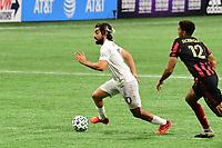 ATLANTA, GA - SEPTEMBER 02: Rodolfo Pizzaro #10 of Inter Miami CF dribbles the ball during a game between Inter Miami CF and Atlanta United FC at Mercedes-Benz Stadium on September 02, 2020 in Atlanta, Georgia.