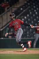 AZL Diamondbacks center fielder Kristian Robinson (10) follows through on his swing during an Arizona League game against the AZL Angels at Tempe Diablo Stadium on June 27, 2018 in Tempe, Arizona. The AZL Angels defeated the AZL Diamondbacks 5-3. (Zachary Lucy/Four Seam Images)