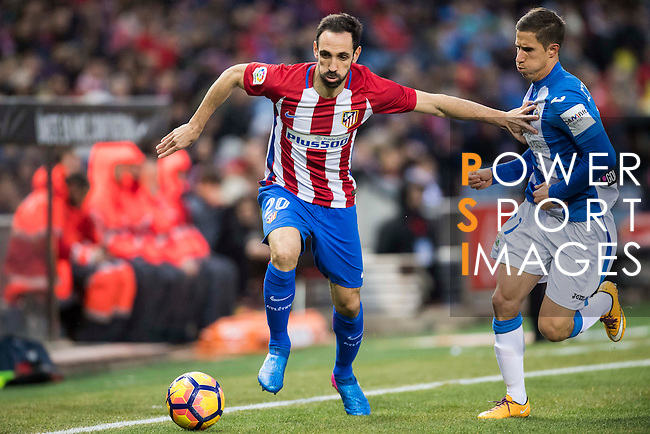 Juan Francisco Torres Belen, Juanfran (l), of Atletico de Madrid competes for the ball with Alexander Szymanowski of Deportivo Leganes during their La Liga match between Atletico de Madrid and Deportivo Leganes at the Vicente Calderón Stadium on 04 February 2017 in Madrid, Spain. Photo by Diego Gonzalez Souto / Power Sport Images